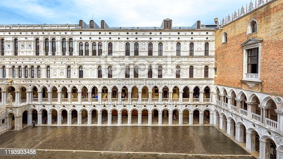 Venice, Italy - May 20, 2017: Doge`s Palace or Palazzo Ducale, Venice, Italy. It is a famous landmark of Venice. Panoramic view of courtyard of old Doge`s house with nice colonnade. Nice Renaissance architecture of Venice.