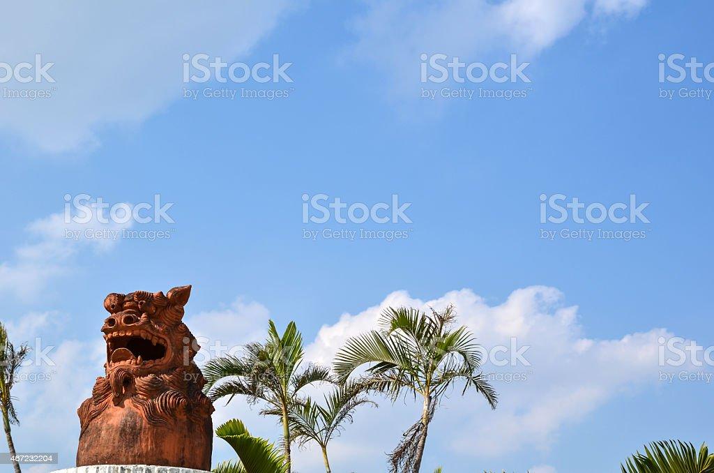 Doglion at palm trees stock photo