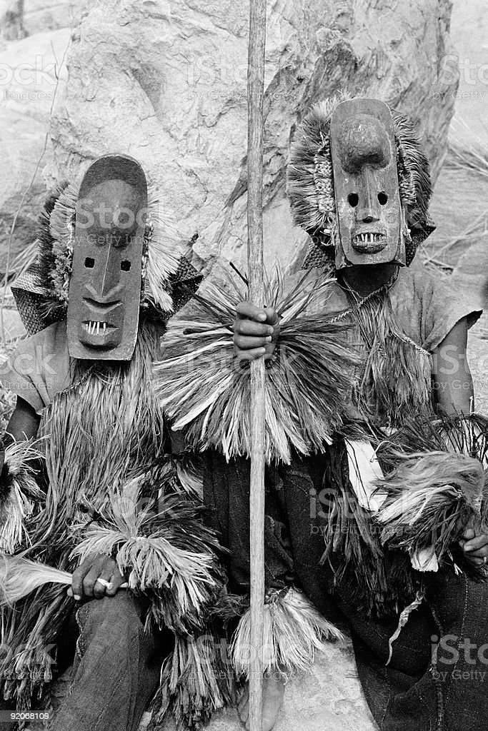 Dogon Dancers - Two with Toothy Masks (b/w) stock photo