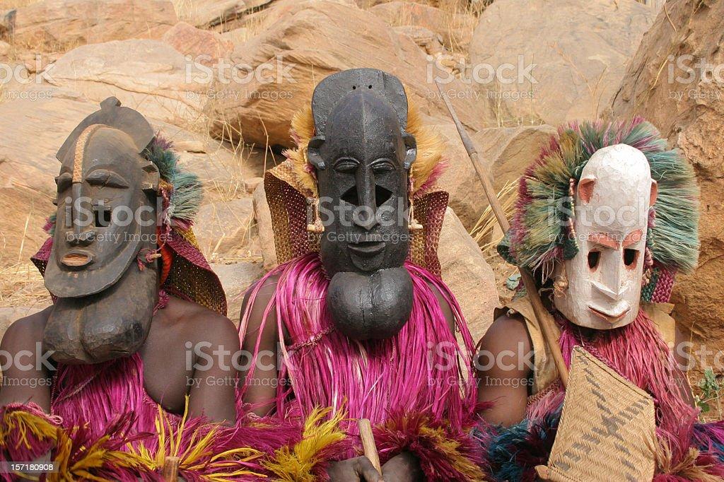 Dogon Masked Dancers -- three human masks stock photo