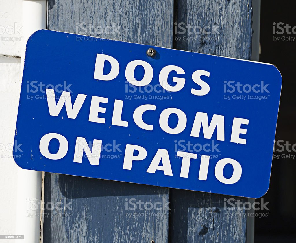 Dogs Welcome on Patio sign royalty-free stock photo