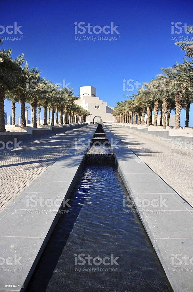 Doha: Islamic Art Museum - palm-tree lined avenue royalty-free stock photo