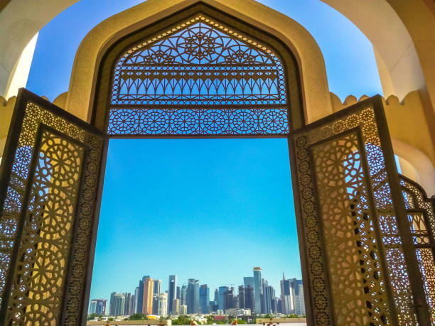 Doha Mosque entrance Modern skyscrapers of Doha West Bay skyline view from State Grand Mosque in Doha, Qatar, Middle East, Arabian Peninsula. Door of entrance at Mosque in Arabian style. grand mosque stock pictures, royalty-free photos & images