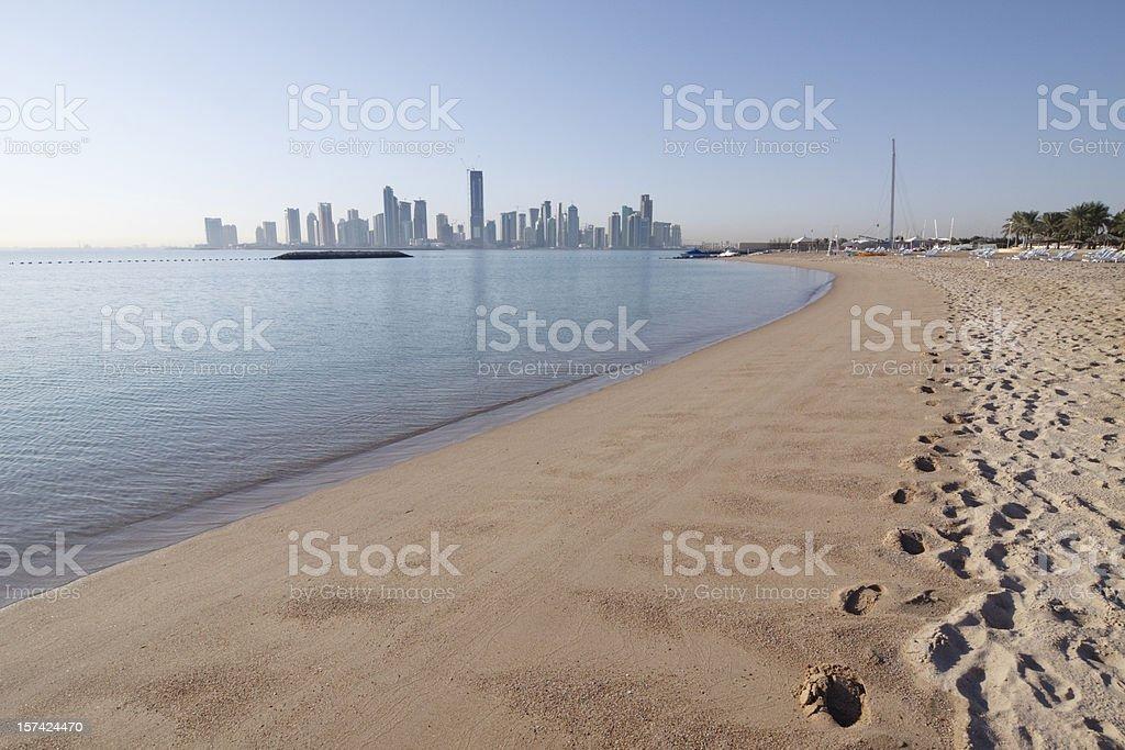 Doha skyline from the beach royalty-free stock photo