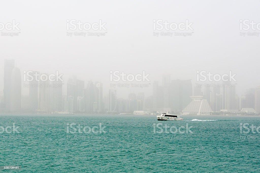 Doha skyline in a sandstorm, Doha, Qatar stock photo
