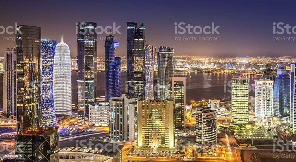 Doha Skyline Panorama, Qatar Cityscape from Above at Night stock photo
