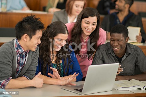 istock Doing a Group Project on a Laptop 508251318