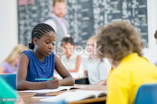 istock Doing a Mathematics Assignment 612659720