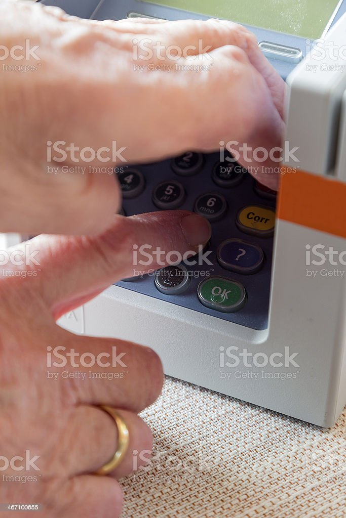 Doing a PIN transaction and prevent skimming stock photo