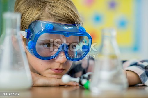 istock Doing A Science Experiment 866699276