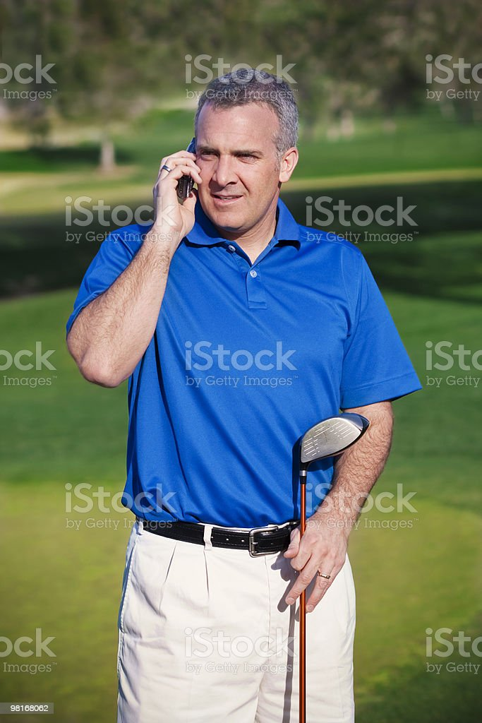 Doing Business on the Golf Course royalty-free stock photo