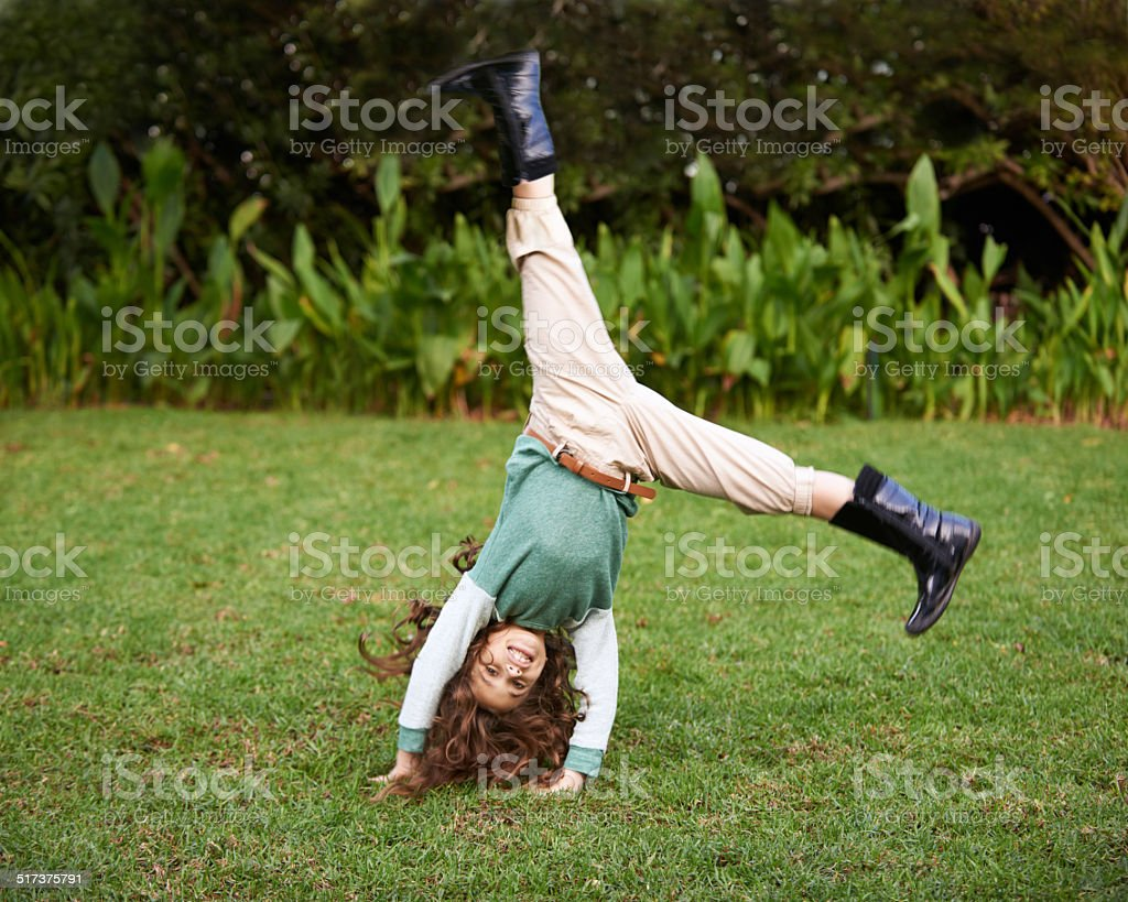 Doing cartwheels is so much fun! stock photo