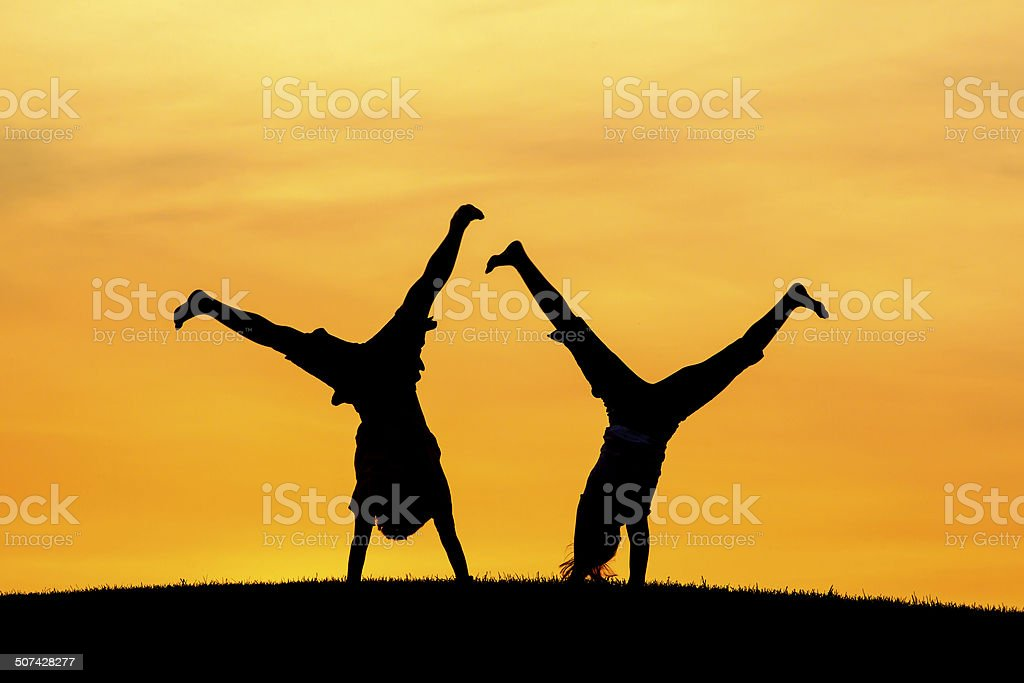 Doing cartwheels together. stock photo