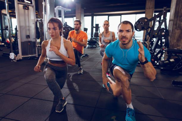 doing crossover reverse lunges - lunge stock photos and pictures