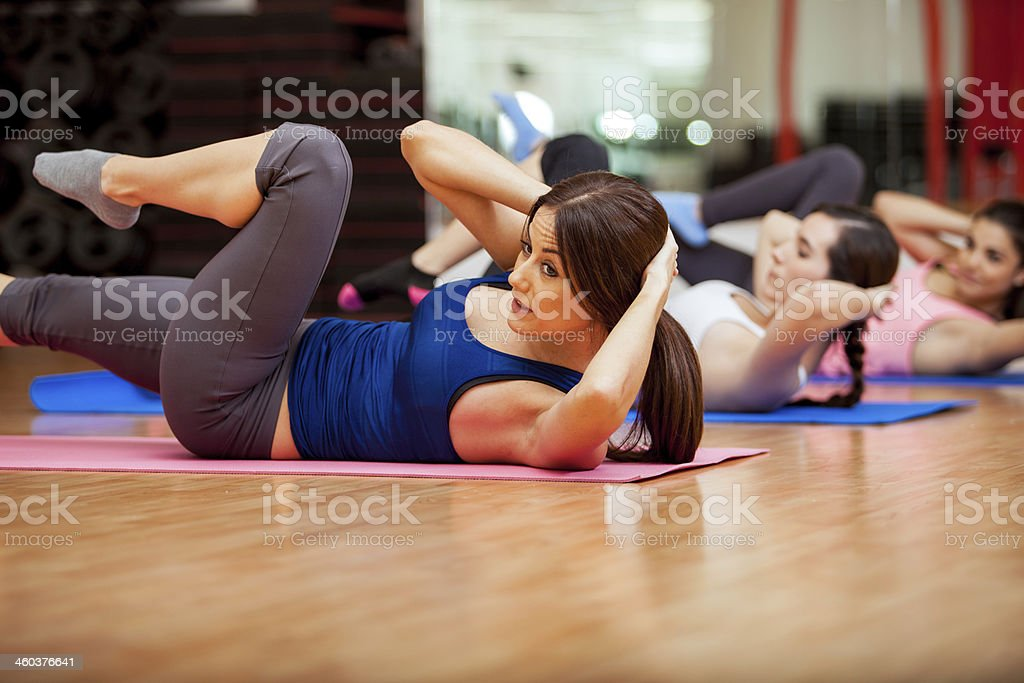 Doing crunches during a gym class stock photo