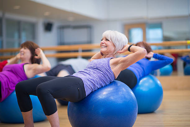 Doing Crunches in a Fitness Class stock photo