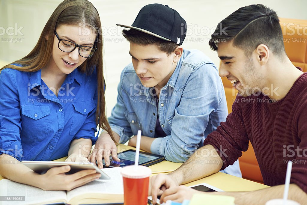 roup of college students discussing group project