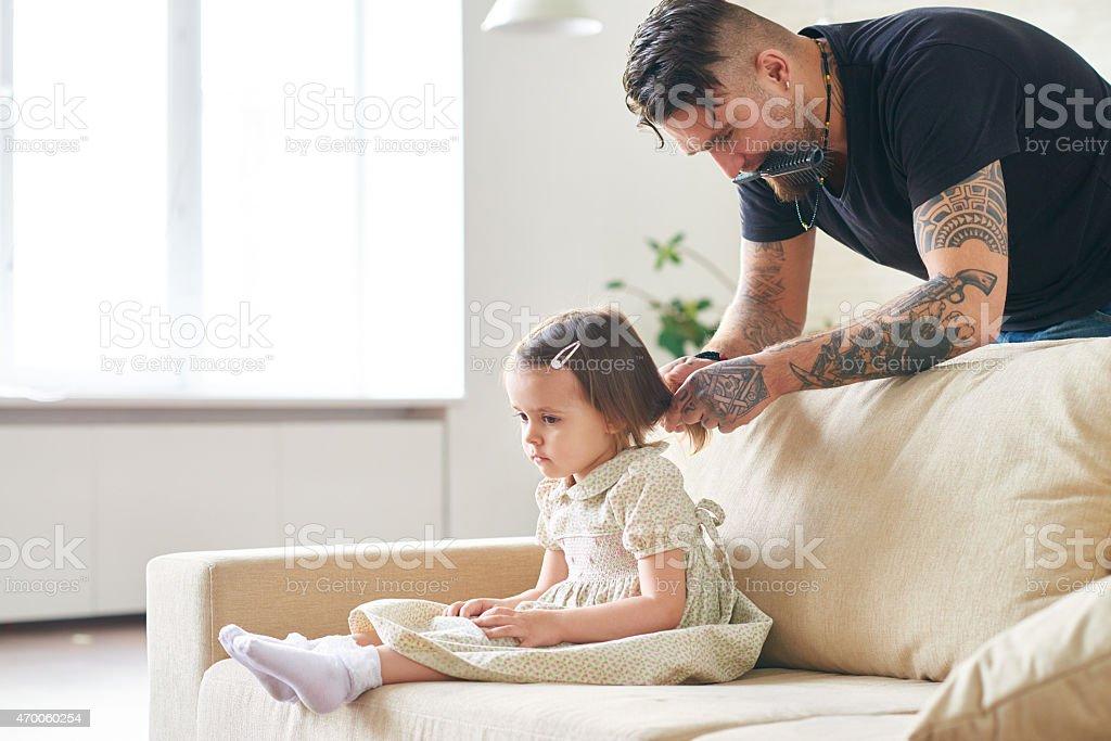 Doing hair for preschool royalty-free stock photo