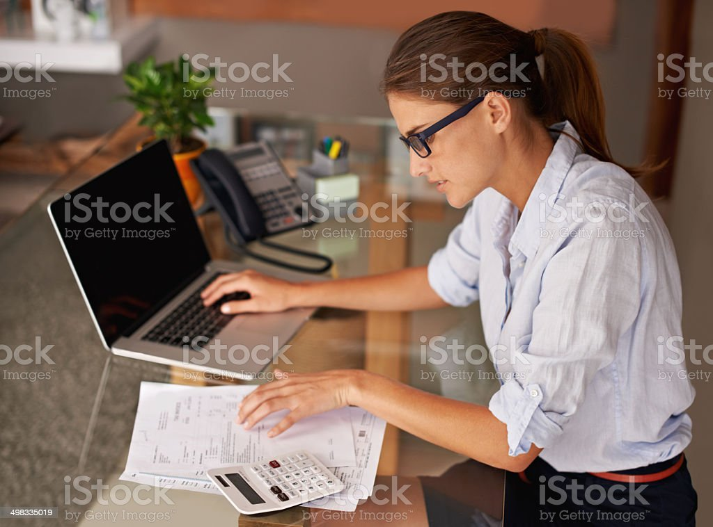 Doing her work at home stock photo