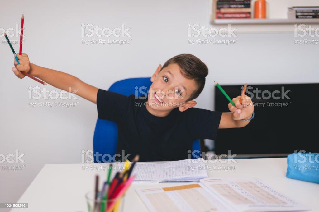 Doing homework can be interesting stock photo