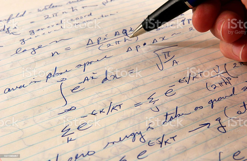 Doing homework Hand holding a pen and doing mathematical calculations on a piece of paper. Color Image Stock Photo