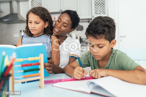 172407626 istock photo Doing homework with mom 1182191888
