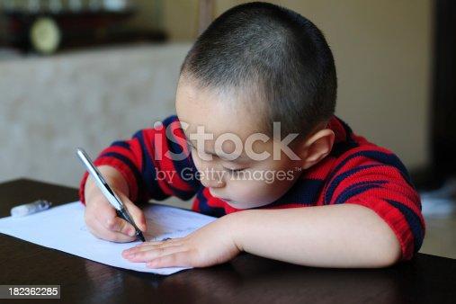 818512928istockphoto Doing Homework - XLarge 182362285