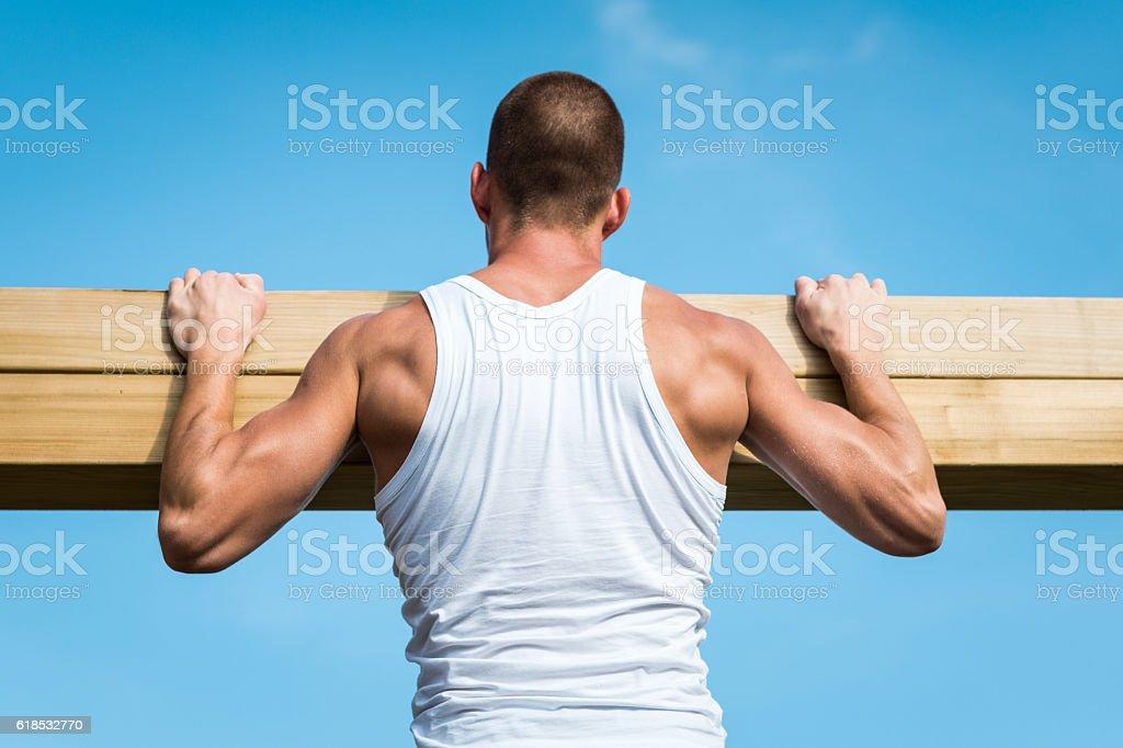 Doing pull-ups stock photo