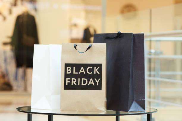 doing purchases during black friday - black friday стоковые фото и изображения