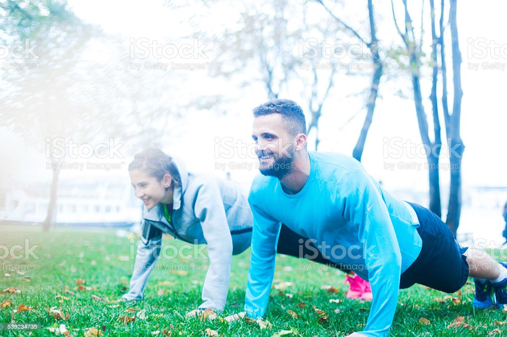 Doing pushup during a running session. royalty-free stock photo