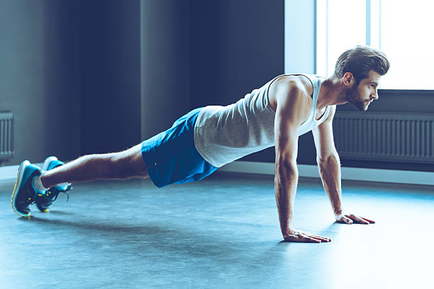 doing push-up. - push up stock photos and pictures