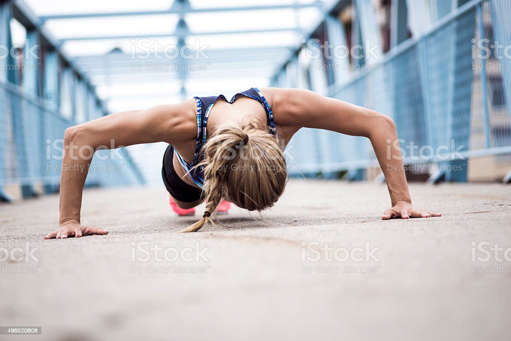 Doing push-ups stock photo