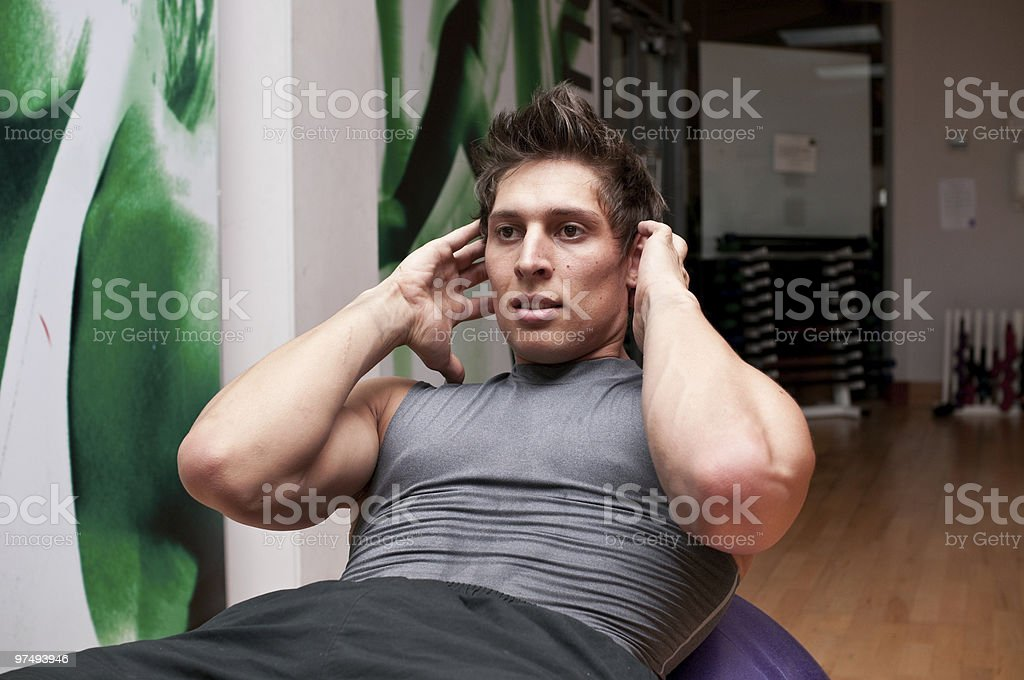 Doing situps on a fitness ball royalty-free stock photo