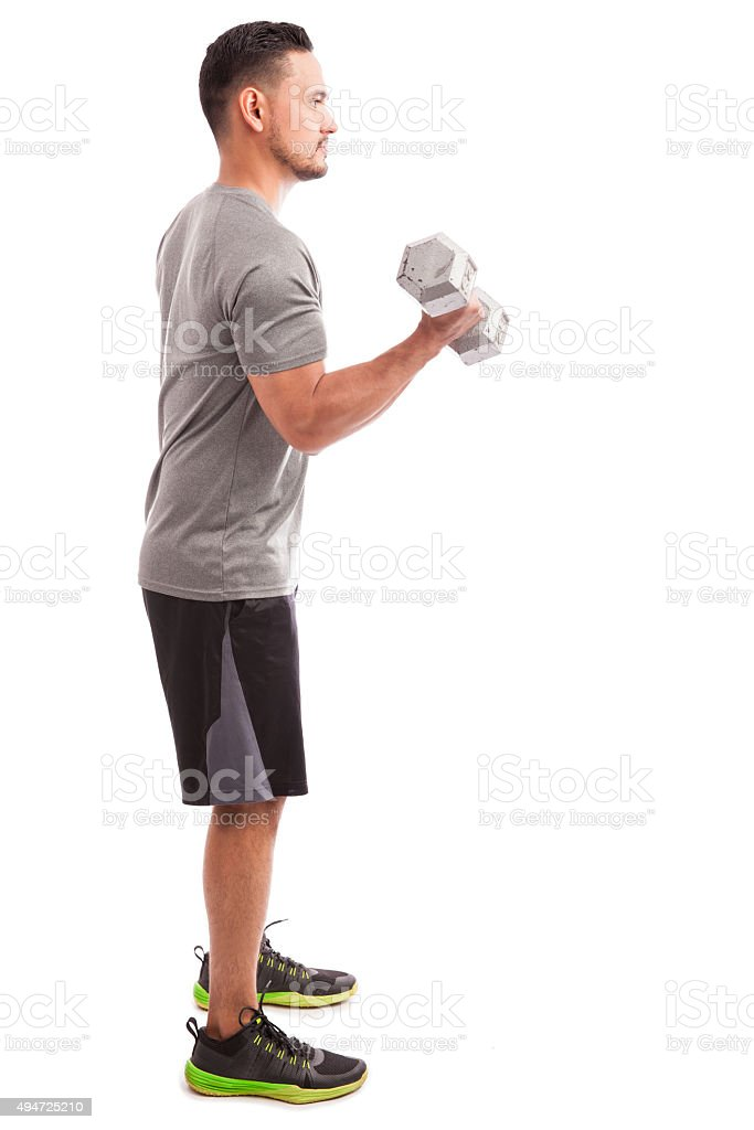 Doing some bicep curls stock photo