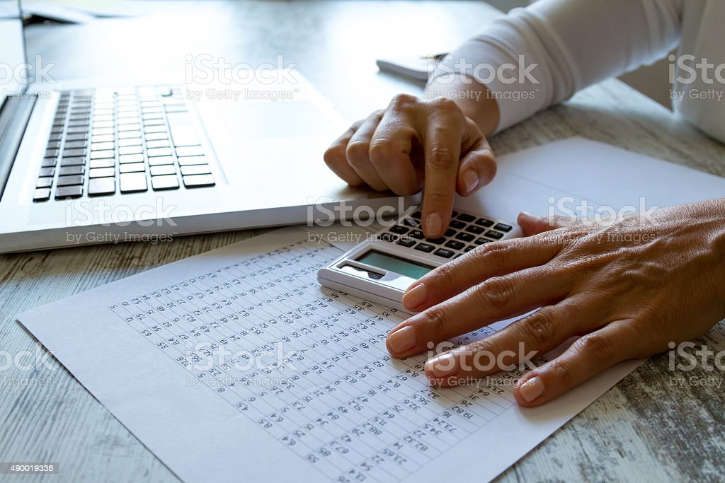 Doing some calculations stock photo
