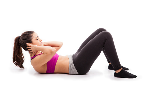 Doing Some Crunches On The Floor Stock Photo Download Image Now