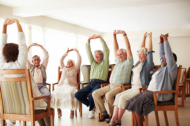 Doing some group exercises stock photo