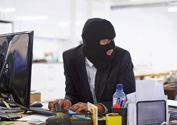 doing some illegal activities... - thief stock photos and pictures