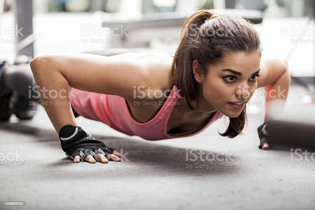 Doing some push ups at the gym stock photo