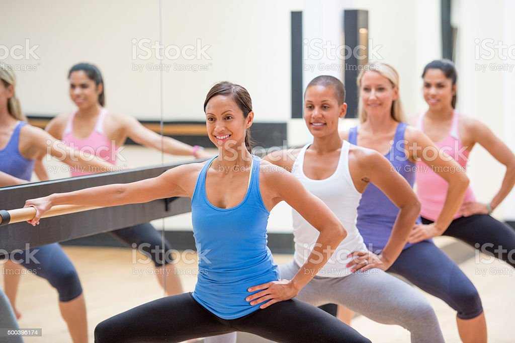 Doing Squats at Barre Class stock photo