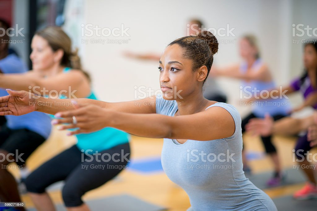 Doing Squats at the Gym stock photo