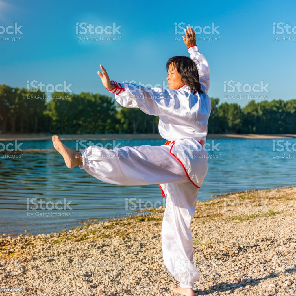 Doing Tai Chi By The Lake stock photo