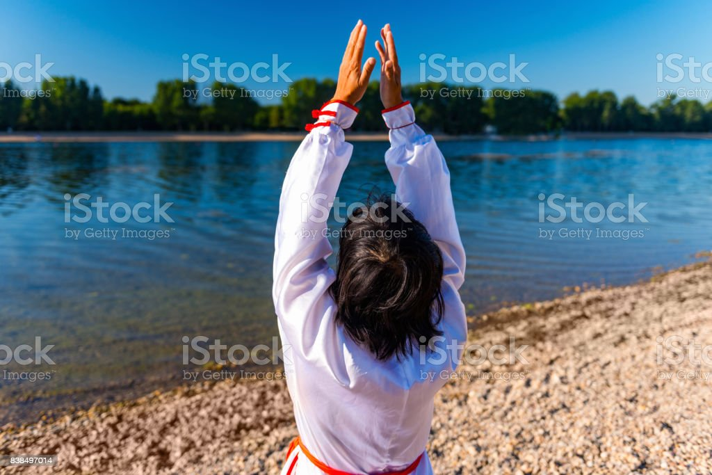 Doing Tai Chi By The Water stock photo
