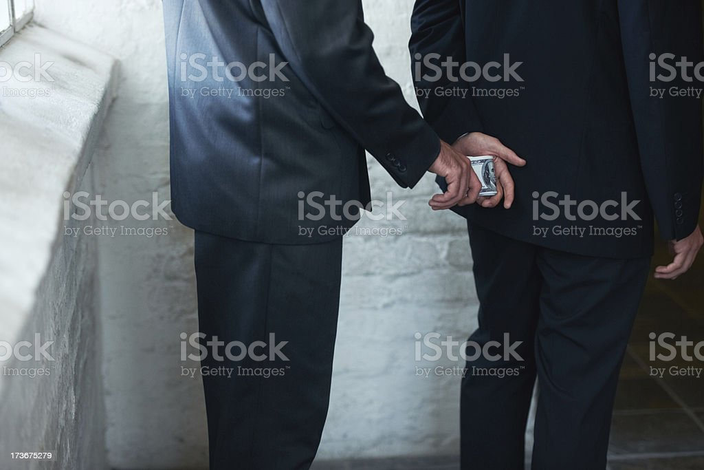 Doing the deal in one sneaky move stock photo