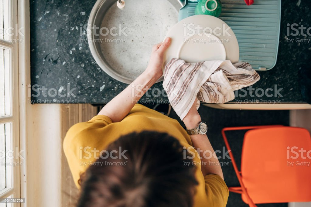 Doing the Dishes at the Office stock photo