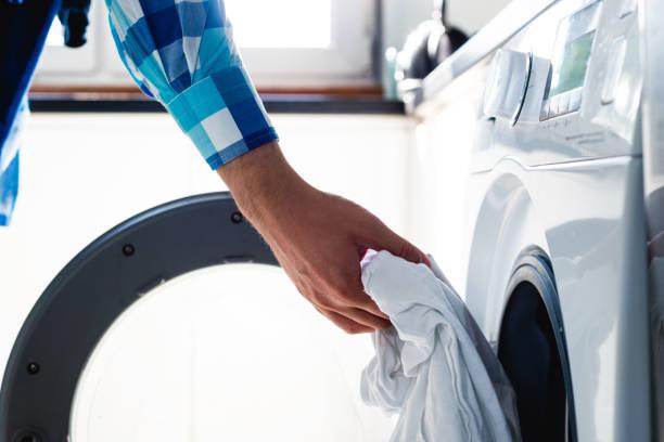 doing the laundry. - стирка стоковые фото и изображения