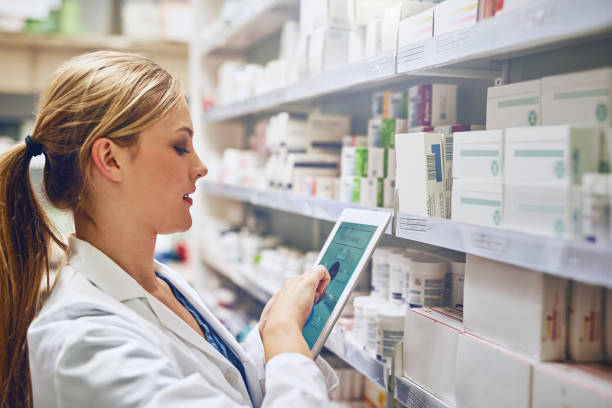 doing what it takes to give you the best care - chemist stock photos and pictures