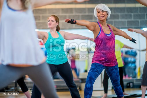 istock Doing Yoga Together 891429302