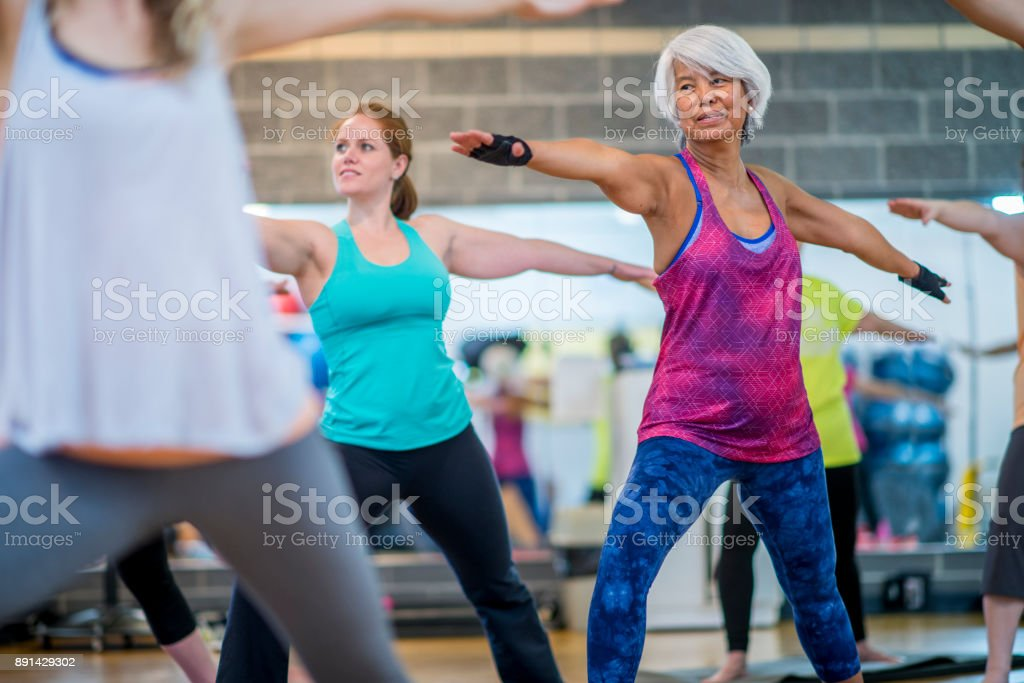 Doing Yoga Together - foto stock
