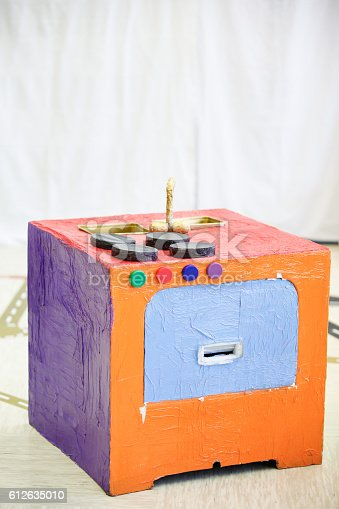 544351868 istock photo Do-it-yourself kitchen stove, made from paper box 612635010